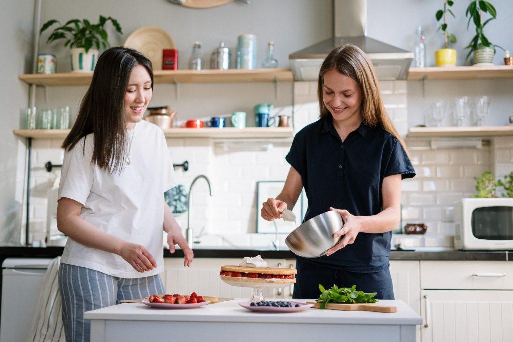 two women following recipe