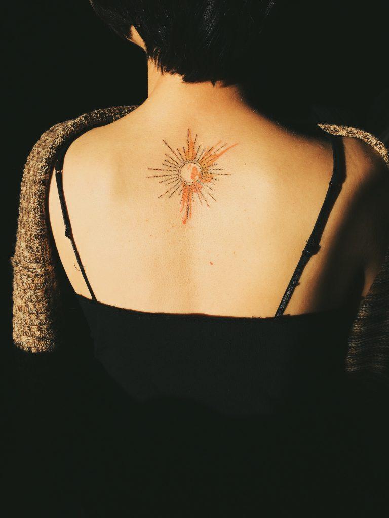 Healed sun tattoo photograph